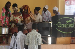 Participants inspecting the fuel efficient stoves